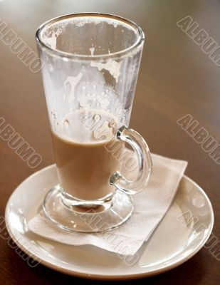 Coffee Latte in a tall glass half empty
