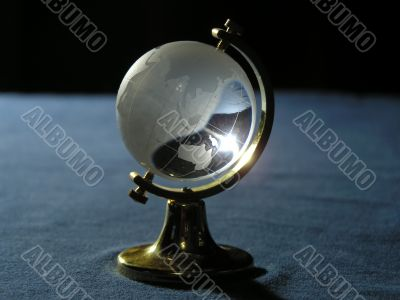 Souvenir. The glass globe on a metal support.