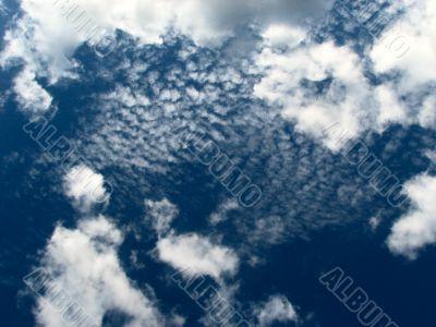 Dark-blue sky with clouds