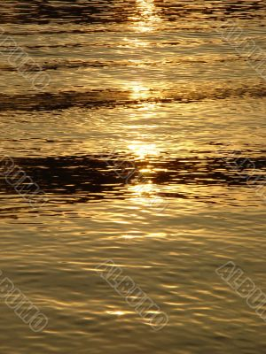 Background. Solar sparks on water.