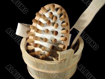 Massage brush in a wooden bucket