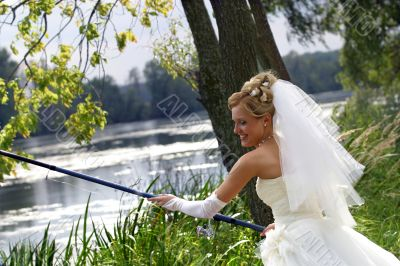 Bride with a fishing tackle