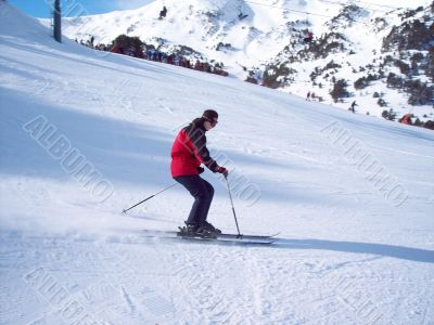 Girl on mountain skis