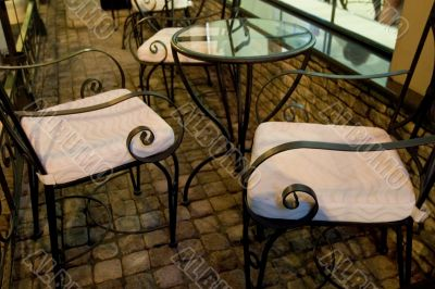 Vintage chairs with curls in cafe