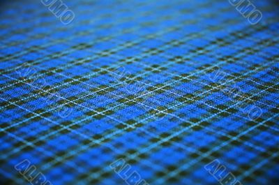 blue checkered fabric background. shallow DOF.