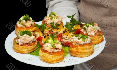 tartlets with salad on dish
