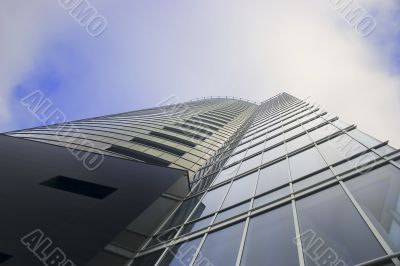Skyscraper on cloudy sky