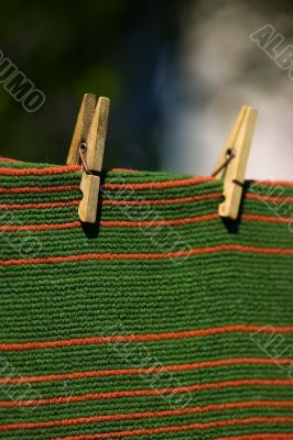 carpet pegged to a clothesline