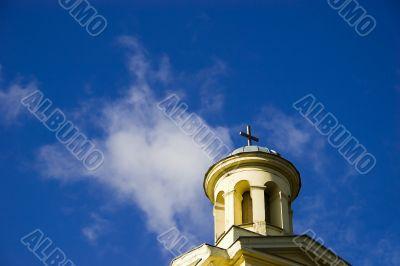 Church tower on blue sky