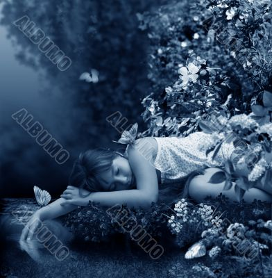 Girl sleeps beside creek