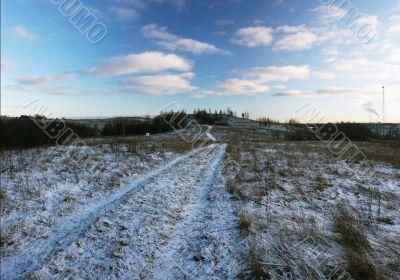 Field road to hills