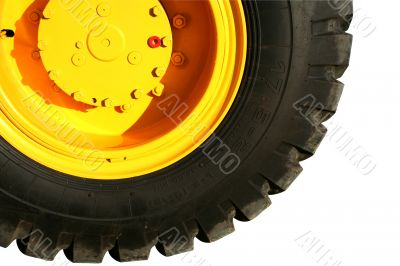 Wheel of the heavy building dozer of yellow color