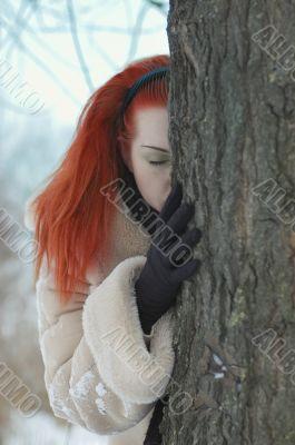 sad girl near a tree