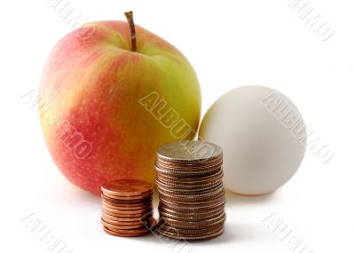 Red green apple and egg with coins