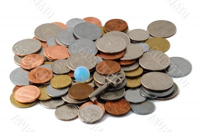 Stack of coins with glass sphere