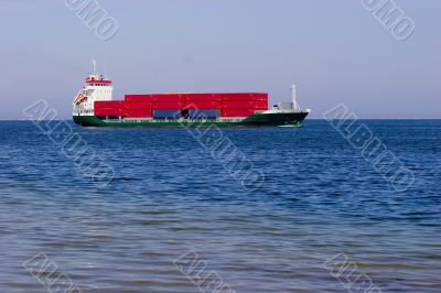 Cargo ship with red containers
