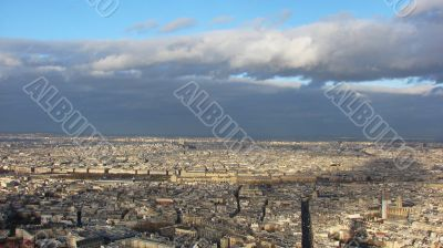 Panorama of Paris with a kind on the Louvre