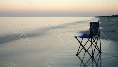 Folding chair on a seaside