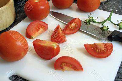 Slicing tomatoes into wedges for a salad