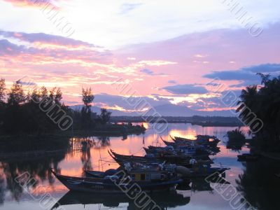 Boats in mooring at sunset