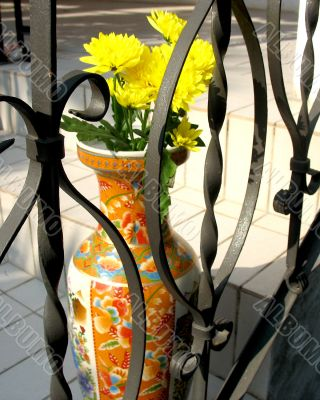 A Vase Behind The Fence