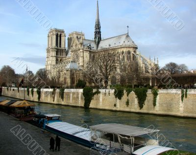 Quay of Paris with a kind on Notre Dame