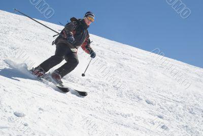 Skier with ski pole on snow and blue sky