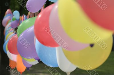 garland of multi-coloured balloons