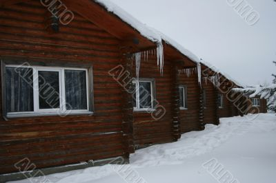 wooden small houses in the winter