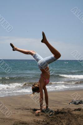 girl, a gymnastics at the seashore