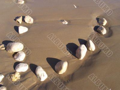 Stone mosaic on marine sand