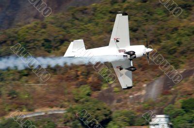 Smoke White Airplane in motion