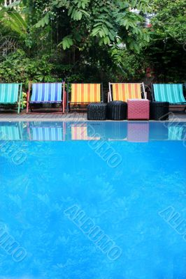 Deck chairs next to a pool
