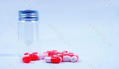 Pills next to jar