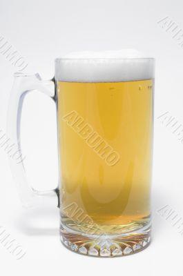 A glass mug of ice cold beer.