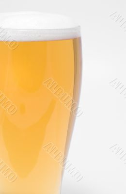 A pilsner glass of ice cold beer.