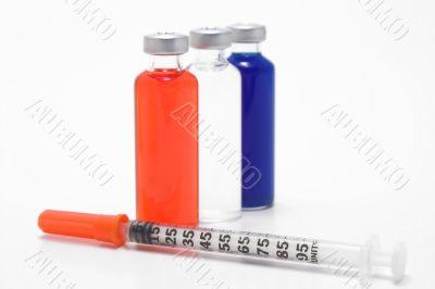 medicine vial and syringe