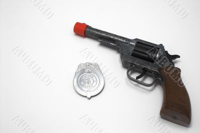 toy gun and badge