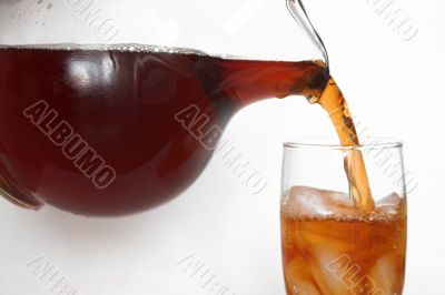 pouring a delicious glass of iced tea