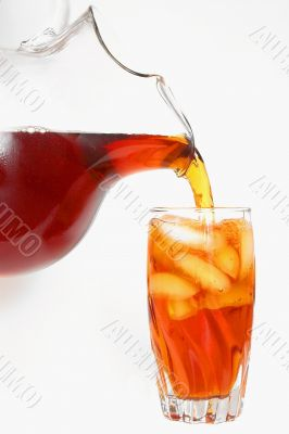 delicious iced tea pouring into a glass