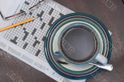a cup of coffe and the morning crossword puzzle