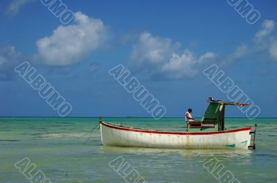 Fisherman in its boat, during an afternoon end