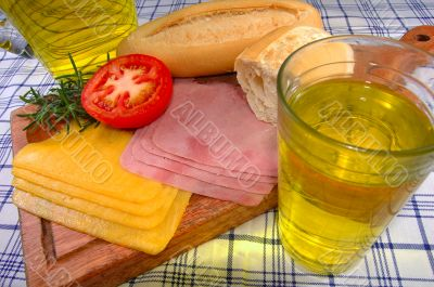 Snack with bread, cheese, ham and juice