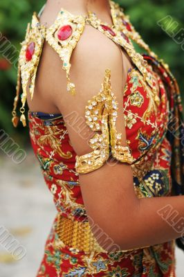 Thai female in bright traditional dress
