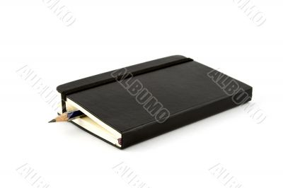 Notebook with pencil inside