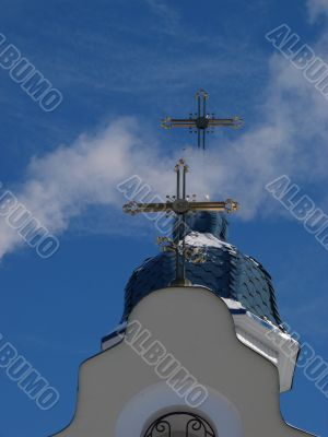 Church Crosses inside white cloud on blue sky