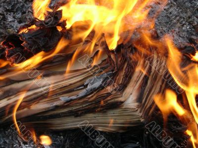 burning stack of paper sheets