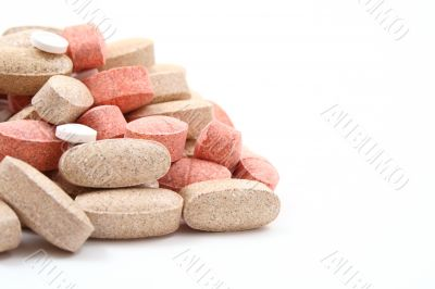 pile of various pills isolated on white