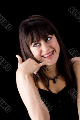 Brunette with brackets on teeth calling
