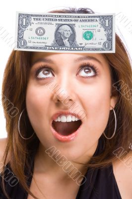 Beautiful Brunette with dollar bill on face